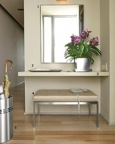 I love how the big mirror, shelf and bench transpires the entrance way and brightens it up with a flower plant