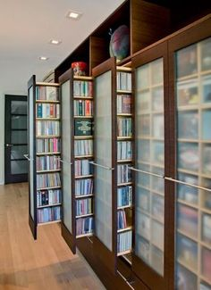 By John Senhauser Architects. This would be a great way to store and organize books. http://sulia.com/my_thoughts/823cbe38-5747-441e-b898-52416a1640f7/?source=pin&action=share&btn=small&form_factor=desktop&pinner=125502693