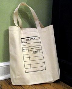 sweet personalized library bags.  funny and strange, though, that library books don't have the little cards anymore...