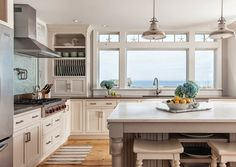 Pretty sure we would burn all our food from being distracted by that view! Love the little coastal accents in this kitchen featured on House of Turquoise!