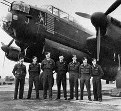 The RAF crew of this Avro Lancaster pose proudly in front of their bomber after completing its 100th operation