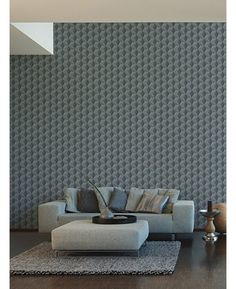 A striking 3D effect geometric wallpaper Ideal for bedrooms and lounges Infused with shimmering glitter particles
