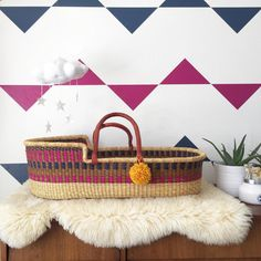 """""""Absolutely smitten with these beautiful Moses baskets by @plumandsparrow! Each one is vegetable dyed and handwoven from dried elephant grass, and provides…"""""""