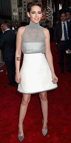 Red Carpet Style at the Hollywood Film Awards | KRISTEN STEWART | In a white mini combined with a chainmail cropped turtleneck (because fashion) and coordinating Casadei gray pumps, Kristen brings some of her signature edge to the red carpet.