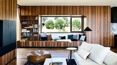 Spotted gum joinery, black stained timber veneer and timber floors create a recessive backdrop to the courtyard at Barwon Heads. Living Room Windows, Living Spaces, Brighton Houses, Masculine Interior, Boundary Walls, Internal Courtyard, Front Rooms, Courtyard House, 4 Bedroom House