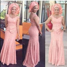 African fashion and style. Light coral pink Nigerian wedding bride gele long dress