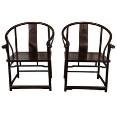 A Late Qing Pair of Chinese Black-Wood Oxbow Armchairs | From a unique collection of antique and modern furniture at http://www.1stdibs.com/furniture/asian-art-furniture/furniture/