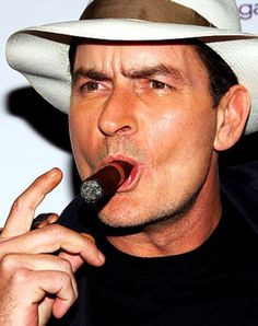 Charlie  Sheen smoking a cigar in Two and a half Men