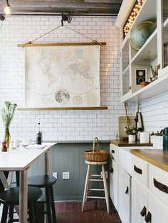 Old map decor in kitchen