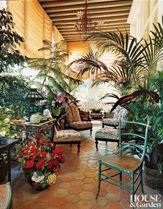 Hemingway style porch love the floor and plants