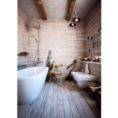 Wooden environment and white bathtub. It might be expensive but it set the mood right.
