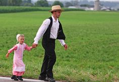 Amish father and daughter, Intercourse, PA.