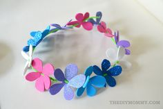 Make a floral crown from foam sheets, pipe cleaners and ribbon. The DIY Mommy.