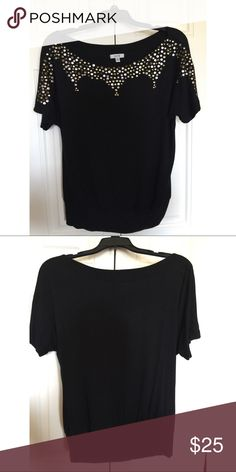 Cache Size Medium Blouse with gold embellishment Barely worn and in great used condition. Size medium and fabric is stretchy. It tightens around the waistline and gives a flattering look. Perfect for work or a special occasion. Cache Tops Blouses