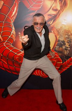 Stan Lee. Look at how happy he is posing infront of one of the greatest movie posters of all time for the greatest spiderman ever!! :3