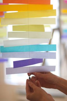 colorful mobiles with velum and a sewing machine-- could be adapted with various shapes