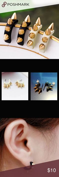 (P1) Spike Earrings You can pick either the black pair or the white pair. Listing is for one pair of earrings. Gold toned spikes. New in package. Jewelry Earrings