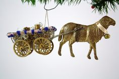 Incredibly detailed Dresden ornament showing a ram pulling a Sebnitz cart filled with two golden milk containers via Betty Bell Antiques