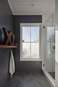 Stunning bathroom interior with herringbone floor.