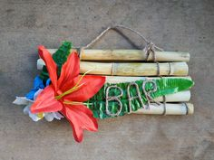 Tiki wall hanging, tropical decor, hawaiian home, tiki bar sign, bamboo decor, tropical flowers, greenery, cocktail hour, bamboo wall hanging, exotic leaves, polynesian decor.  One of a kind tropical wall hanging, with bamboo, exotic flowers and leaves. Perfect to decorate your tiki bar, pool area, living room, patio and would make a unique housewarming gift! Handmade with love! Only one made!