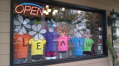 "Simple, brightly colored products pop against a busy, black-and-white background at Lela Lu's Active Wear Boutique in Carrolton, GA.    For ideas on how to create your own colorful summer windows, see ""Bright Ideas"" on page 29 of the April 2012 issue of DRN.    (Photo Courtesy of Lela Lu's Active Wear Boutique)"