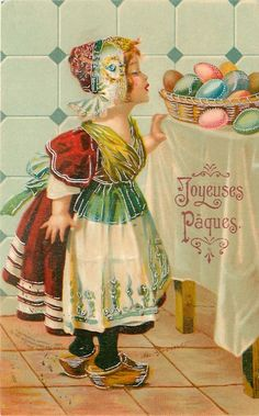 Antique Easter Postcard... Dutch girl looks at basket of Easter eggs on table