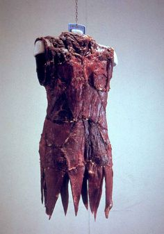 Vanitas: Flesh Dress for an Albino Anorectic, 1987 (composed of fifty pieces of flank steak that cured over a period of several weeks until the artist replaced it with a fresh meat dress)