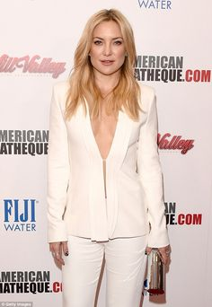 Taking the plunge: Kate Hudson showed some skin as she arrived on the red carpet of the29...