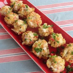 "Baked Crab Popper Delights ""The perfect crab appetizer! No one needs to know how quick and easy these are. With a bit of heat, the red pepper adds a punch of flavor and the sauce you brush on top is a great touch."""
