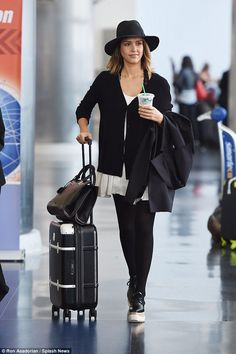 Down to earth: Jessica Alba looked a million dollars after landing at JFK airport in New York on Monday