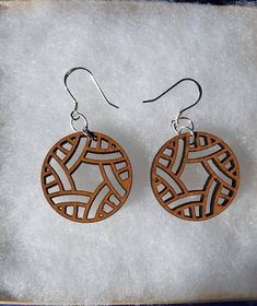 Solid Maple Earrings. These Earrings are laser cut to create a matching pair. The Fish Hook wire and jump rings are Sterling Silver They measure approximately 1 x 1 x 1/8 Have a custom design in mind? Please contact me.