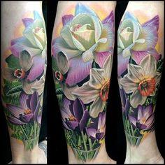 Violet, rose, daffodil tattoo -