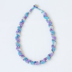 Crochet necklace in shades of blue and purple Spiral beaded jewelry... ($9.50) ❤ liked on Polyvore featuring jewelry, necklaces, vintage style necklace, bohemian jewelry, boho jewelry, crochet jewelry and crochet necklace