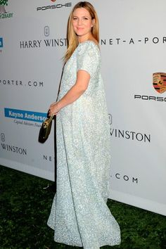 Drew Barrymore ensures all eyes are firmly fixed on this stunning pale blue gown by Tory Burch at the Baby2Baby Gala in LA. This is flawless maternity evening wear at its best.