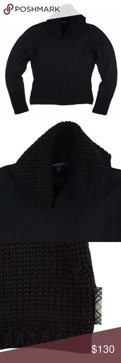 "BURBERRY LONDON Black Merino Cowl Neck Sweater Excellent condition! This black cowl neck sweater from Burberry London features a cowl neckline and Burberry Plaid logo tab at bottom side. Made of a warm weighted 100% merino wool. Measures: bust: 37"", total length: 22"", sleeves: 26"" Burberry Sweaters Cowl & Turtlenecks"