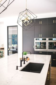 Geometry has never looked so good. The Hudson Valley Roundout chandelier is a bold look in this stylish kitchen!   Photo credit: Mabel Cheung  #BlackAndBrassLighting #KitchenLightingIdeas #IslandLighting #GeometricLighting Kitchen Lighting Fixtures, Stylish Kitchen, Cozy Place, Island Lighting, Next At Home, Hudson Valley, Easy Projects, Home Improvement Projects, Light Decorations