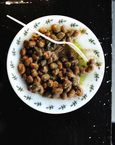 Cumin and lemon bring a smoky and tart savoriness to this classic Egyptian bean dish. Serve it as a side dish or vegan main course.