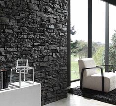 black stone walll with white modern furniture. SO elegant. DIY with our black rumble ledgestone panels.