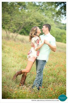Beautiful Aledo Couple Portraits 2014 | Great pose idea of Husband & Wife dancing in field of wildflowers in boots| amandalynnphoto.com | Amanda Lynn Photography