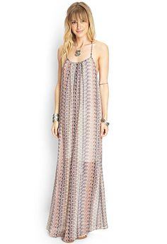 Front pleats enhance the unstructured silhouette of this airy maxi dress, and the eye-catching al...