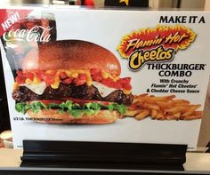 Carl's Jr. Flamin' Hot Cheetos Burger | with Cheetos, cheese sauce, what looks to be pepper jack cheese, a Thickburger Angus patty, lettuce, and tomato.