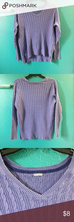 Purple stretchy swearter A purple stretchy sweater, has a spilt on the side of the sweater, it's perfect for the winter, it's long sleeve. Size is median its in excellent condition.Pet free, and smoke-free clean environment. No rips, no holes, no flaws. Sweaters