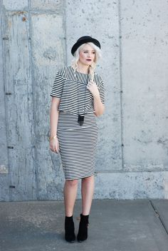 www.theredclosetdiary.com    Fashion blogger wearing a black and white striped dress with black booties and a black hat with platinum hair!