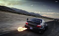 Subaru Impreza STI shooting flames from the exhaust