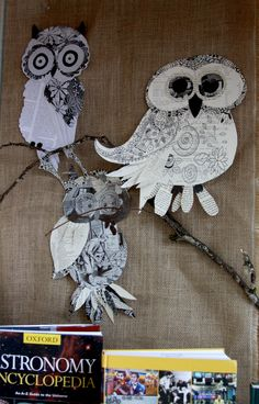 Owls made from discarded book pages for library reference collection display.