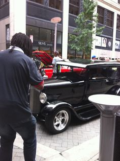 News reporter taking pictures - 2013 Street Rod Nationals downtown Louisville, KY