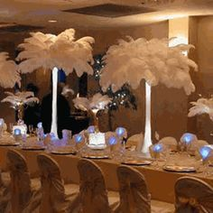 Apparently ostrich feather centerpieces became popular in the late 1940s  DIY: How to make Ostrich Feather  tower vase arrangements