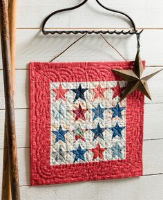 Stars and Stars quilt from Moda All-Stars: Mini Marvels: Creative way to hang a quilt.