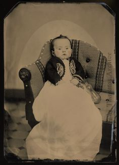 Deceased infant with nursing bottle.  In the pre-sterilization era, the bacteria from this type of nursing bottle led to the deaths of many children.  Full-plate tintype, c.1870.