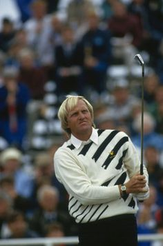 Greg Norman in 1986 when he won the Open Championship wearing Lyle and Scott.